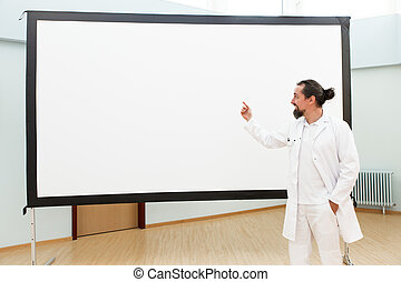 doctor is standing in front of a empty whiteboard