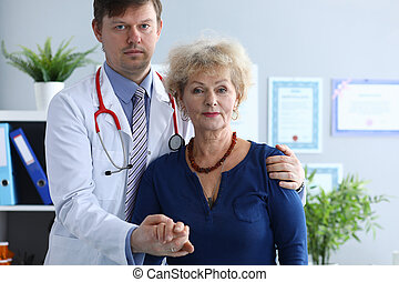 Doctor is standing with female patient in hospital