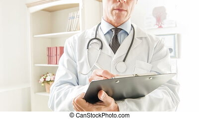 Doctor is writing down data.