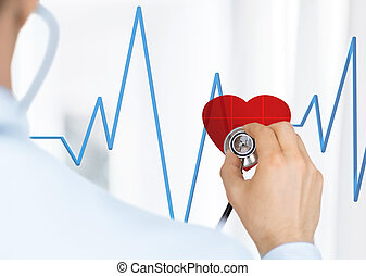 doctor listening to heart beat - doctor with stethoscope...