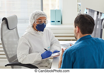 Doctor listening to the patient