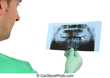 Doctor looking at x-ray (isolated on white)