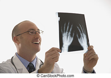 Doctor looking at xrays.
