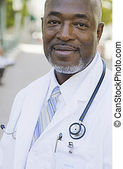 Doctor looking Directly To Camera - Portrait of Doctor with...