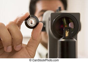 Doctor Looking Through Eye Exam Machine
