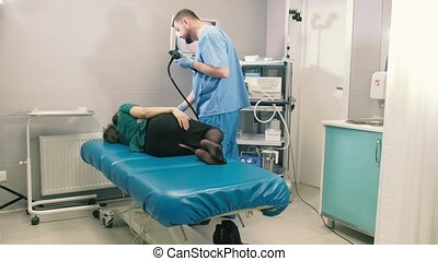 Doctor makes a gastroscopy young girl through the mouth
