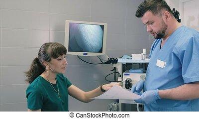 Doctor makes a gastroscopy young girl through the mouth 4k