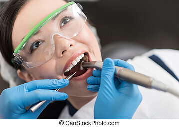 Doctor making treatment of mouth in stomatology