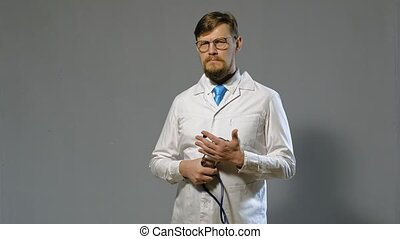 doctor man in white coat on gray background, medicine concept