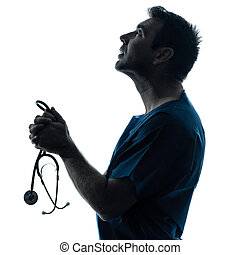 doctor man praying silhouette portrait