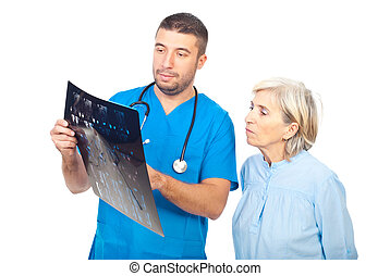 Doctor man showing MRI to his senior patient