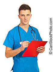 Doctor man writing in clipboard