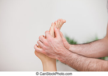 Doctor manipulating the foot of his patient