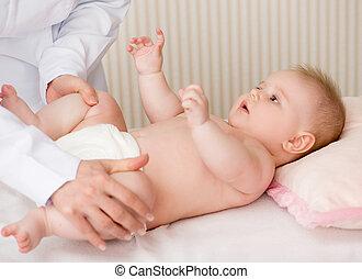 Doctor massaging  baby