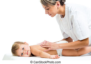 doctor massaging or doing gymnastics baby girl