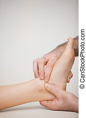 Doctor massaging the side of a foot