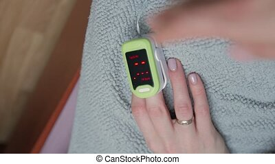 Doctor measures patient oxygen level oximeter closeup