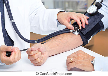 Doctor measuring patient blood pressure.