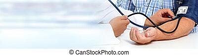 Senior man measuring his blood pressure at medical clinic.