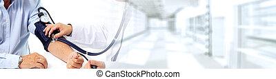 Doctor measuring patient blood pressure.