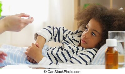 doctor measuring sick girl's temperature - healthcare, ...