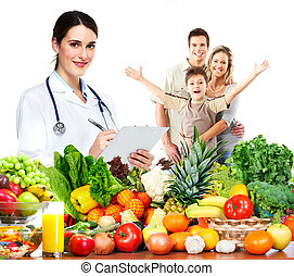 Doctor nutritionist and family. - Doctor with vegetables and...