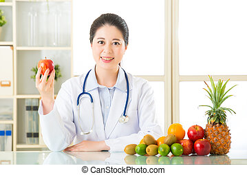 Doctor nutritionist with fruits, healthy eating