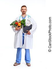 Doctor nutritionist with scales and vegetables.