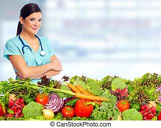 Doctor nutritionist with vegetables.