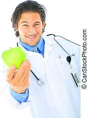Doctor Offering Healthy Food - happy caucasian doctor...