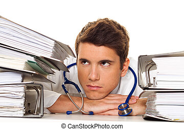 Doctor on stress with stacks of files. Bureaucracy in the hospital.