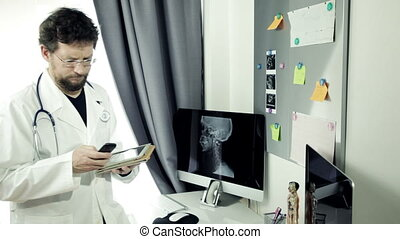 Doctor on the phone with tablet