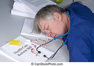 Doctor overdosed - A doctor is slumped over his desk after...