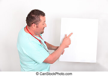 Doctor pointing to a blank sign