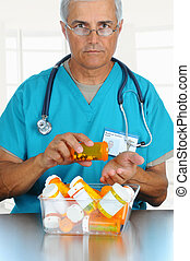 Doctor pouring pills into his hand - Smiling middle aged...