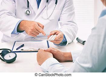 Doctor prescribing medicine to a patient in the office