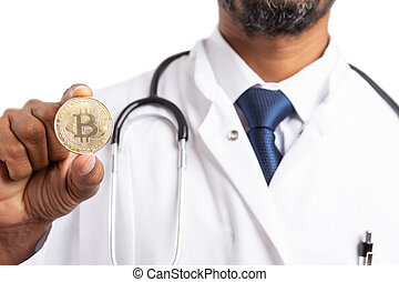 Doctor presenting golden bitcoin