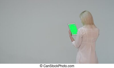 Doctor pressing the green screen of a tablet computer