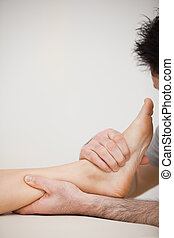 Doctor pressing the side of a foot