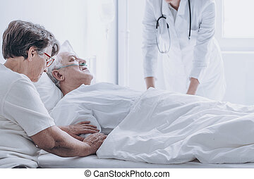 Doctor pronouncing death of patient