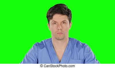 Doctor puts on protetcive mask. Green screen