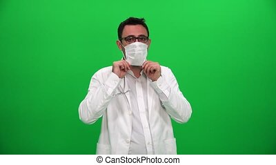 Doctor Putting on Surgical Mask