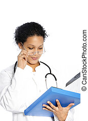 Doctor reading a patients file