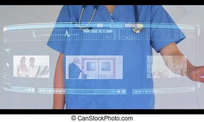 Doctor scrolling through interactiv