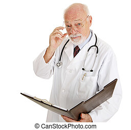 Doctor - Serious About Your Health - Serious mature doctor...