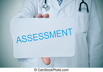 doctor showing a signboard with the word assessment