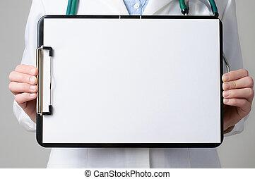 Doctor showing blank clipboard