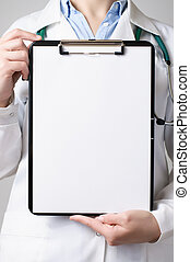Female doctor showing a clipboard with blank paper