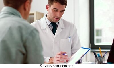 doctor showing cardiogram to patient at hospital