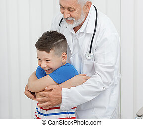 Doctor showing exercises to boy on consultation.